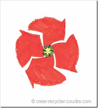 logo pour blog couture écologique : coquelicot avec pétales en forme de flèches recyclage
